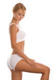 Vrouw die haar been masseert Stock Foto's