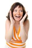 Vrouw die haar gezicht in verbazing houdt Royalty-vrije Stock Fotografie