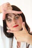 Vrouw die Haar Handen frame Stock Afbeeldingen