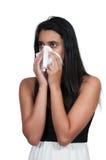 Vrouw die haar neus blaast Stock Fotografie