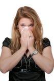 Vrouw die haar neus blaast Royalty-vrije Stock Afbeelding
