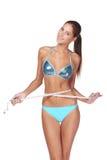 Vrouw die haar slank lichaam meet Stock Foto