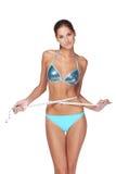 Vrouw die haar slank lichaam meet Stock Foto's
