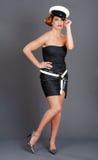 Vrouw die marinehoed draagt Stock Afbeeldingen
