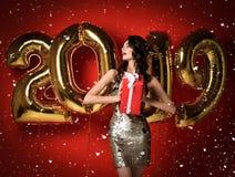 Vrouw die met Ballons bij Partij vieren stock fotografie
