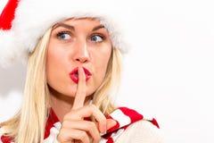 Vrouw die met Kerstmanhoed stil gebaar maken stock foto
