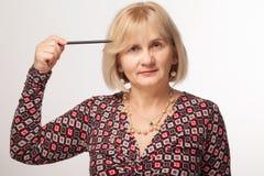 Vrouw die met pen richt Royalty-vrije Stock Fotografie