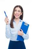 Vrouw die met pen richt Stock Foto's