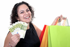 Vrouw die met rekeningen van 100 euro winkelt Royalty-vrije Stock Foto's