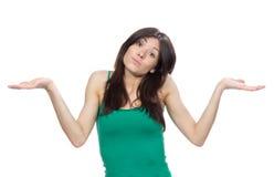 Vrouw die met verrast gezicht handpositie vergelijkt Stock Foto's