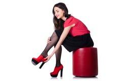Vrouw die nieuwe geïsoleerde schoenen proberen Royalty-vrije Stock Foto's