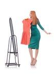 Vrouw die nieuwe kleding proberen Royalty-vrije Stock Afbeelding