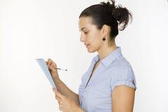 Vrouw die nota neemt royalty-vrije stock afbeelding