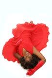 Vrouw die op wit in rode kleding wordt geïsoleerdn Royalty-vrije Stock Afbeeldingen