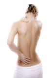 Vrouw die pijnrug masseert Stock Fotografie