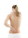 Vrouw die pijnrug masseert royalty-vrije stock foto