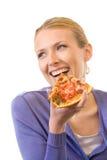 Vrouw die pizza eet Royalty-vrije Stock Afbeelding