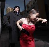 Vrouw die probeert te ontsnappen Stock Foto's