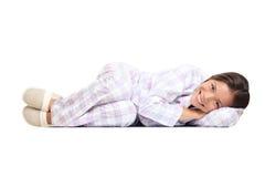 Vrouw die in pyjama's wordt geïsoleerdh Royalty-vrije Stock Afbeeldingen