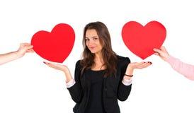 Vrouw die rode harten ontvangen Stock Foto's