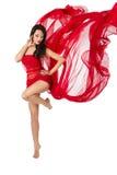 Vrouw die in rode vliegende kleding danst. Over wit Royalty-vrije Stock Foto