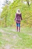 Vrouw die rubberlaarzen draagt Royalty-vrije Stock Foto