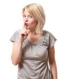 Vrouw die shh zegt stock afbeeldingen