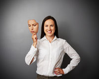 Vrouw die stil masker houden stock fotografie
