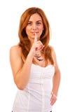 Vrouw die stilteteken geven Stock Afbeeldingen