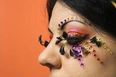Vrouw die unieke make-up draagt. Royalty-vrije Stock Foto