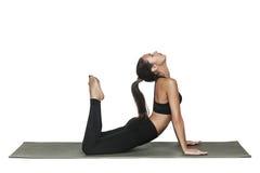 Vrouw die yoga doet Geïsoleerd op wit Royalty-vrije Stock Fotografie
