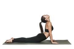 Vrouw die yoga doet Geïsoleerd op wit Royalty-vrije Stock Afbeelding