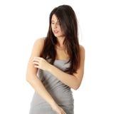 Vrouw die zelf haar scraching Stock Fotografie