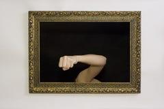 Vrouw in een het schilderen frame stock afbeeldingen