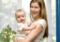 Vrouw en baby Stock Afbeeldingen