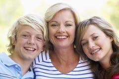 Vrouw en Haar TienerKinderen Stock Foto's