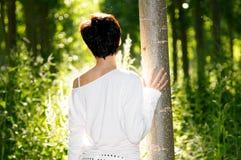Vrouw en het licht Stock Afbeeldingen