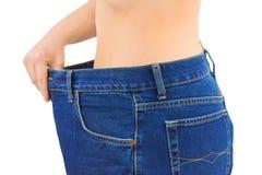 Vrouw en jeans - vermageringsdieet Stock Foto