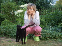 Vrouw en kat Stock Afbeeldingen