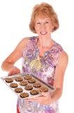 Vrouw en koekjes Royalty-vrije Stock Afbeeldingen
