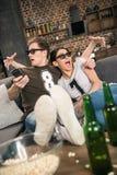 Vrouw en man in 3D glazen Stock Foto