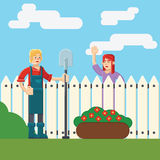 Vrouw en man dichtbij omheining wicket in tuin Stock Afbeeldingen