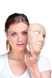 Vrouw en masker. Stock Afbeelding