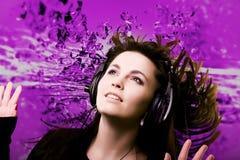Vrouw en muziek Stock Foto