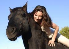 Vrouw en paard Stock Afbeeldingen