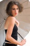 Vrouw en paraplu Royalty-vrije Stock Afbeeldingen