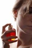 Vrouw en parfum Royalty-vrije Stock Foto's