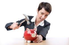 Vrouw en piggybank Stock Foto