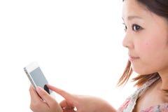 Vrouw en smartphone Stock Foto's