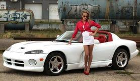 Vrouw en sportwagen Royalty-vrije Stock Afbeelding